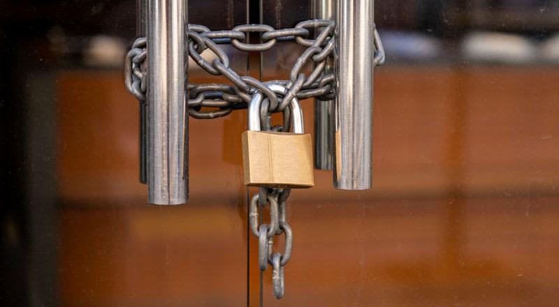 Door handles on glass door with chain and lock
